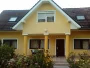 4 lakásos, kiváló állapotú és elosztású, szép kerttel rendelkező családi ház a belvárosban