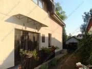 XVI. Sashalmon Újszász u.közelében kiadó 5 szobás, ikerház fél, kerttel, garázzsal.