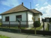 Közel a Román határhoz, Porcsalmán jó állapotú tégla építésű ház dupla telekkel